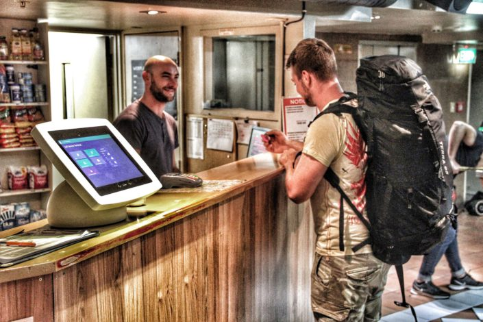 Image of the Choice Backpackers recepting showing a guest checking in