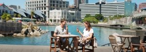 couple eating at water front